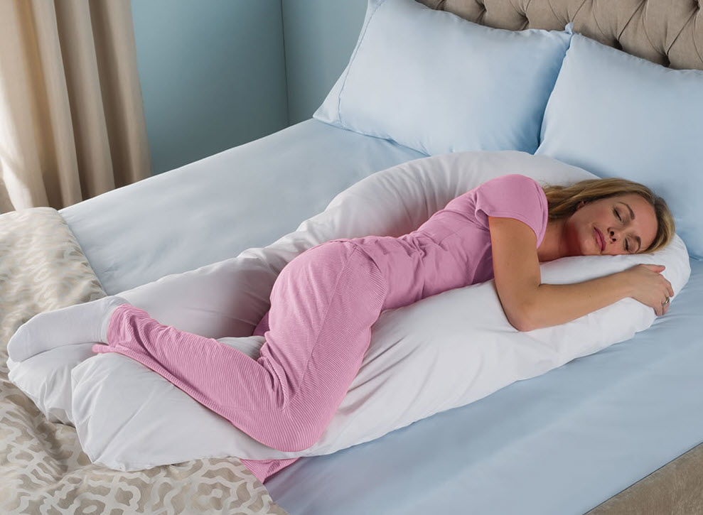 woman sleeping on body pillow